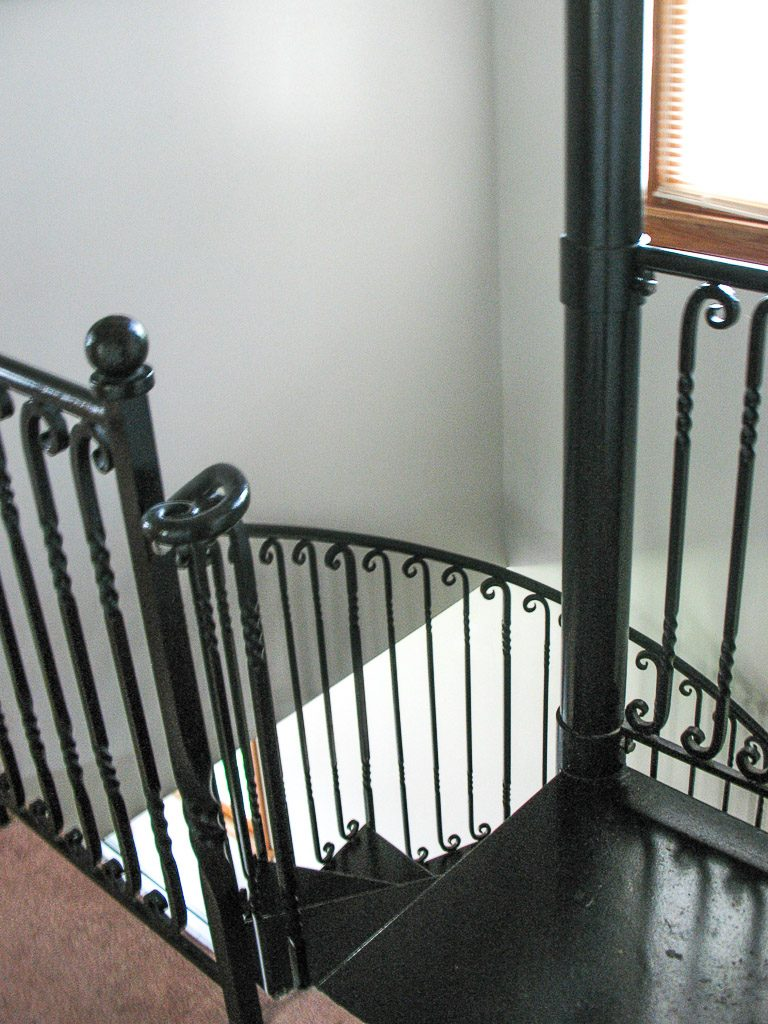 The top landing of a custom spiral staircase