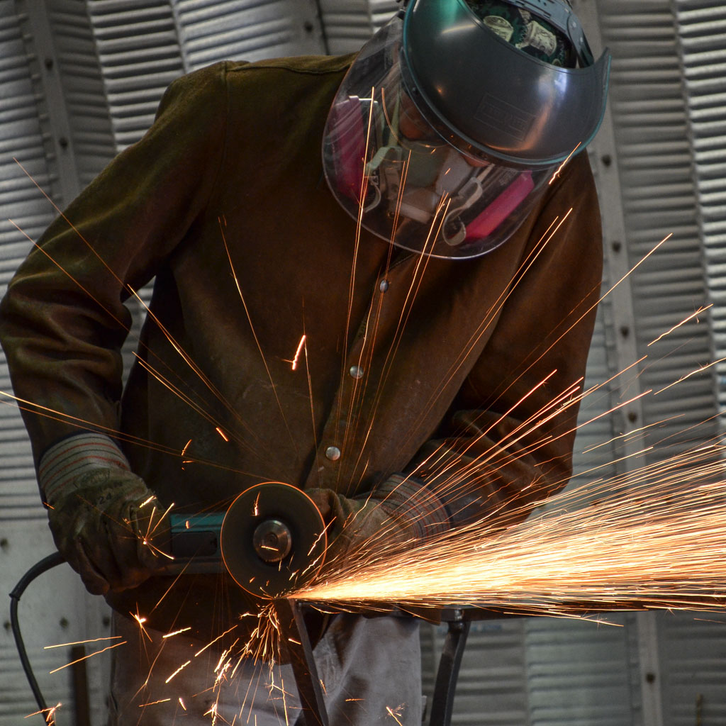 Jerry Dornbach grinding metal, sparks flying