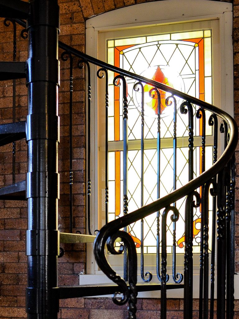 Custom blacksmith forged spiral stairs