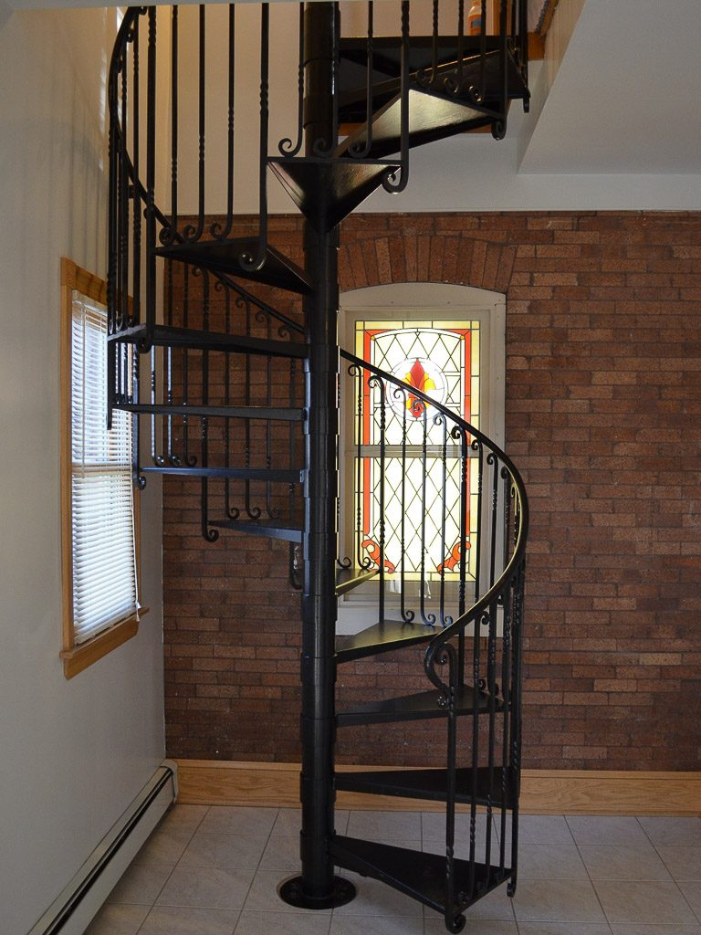 A custom designed hand forged iron spiral staircase