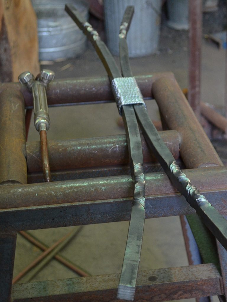 A forged iron furniture component