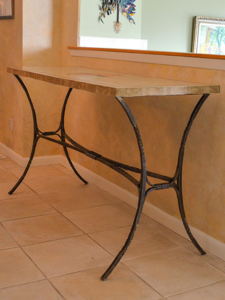 A custom blacksmith forged iron console table