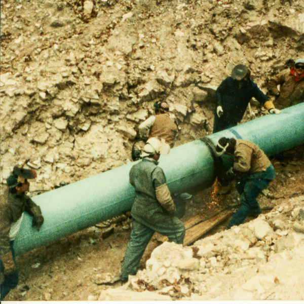 men welding a gas pipeline
