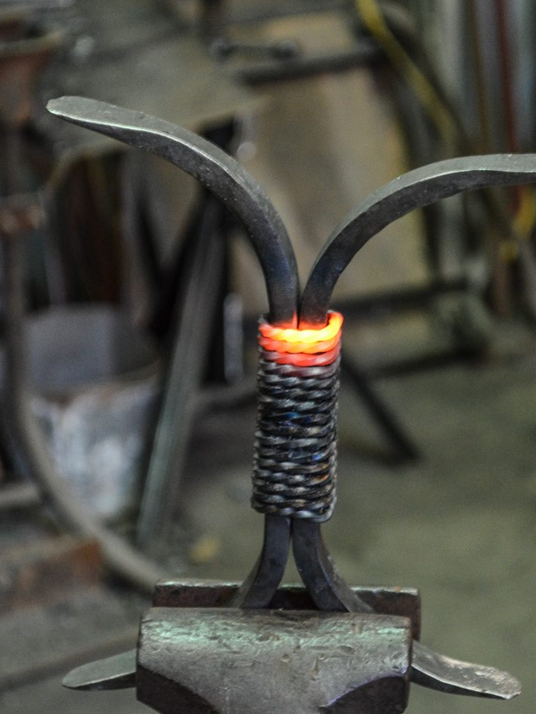 iron furniture component with a red-hot twisted wrap