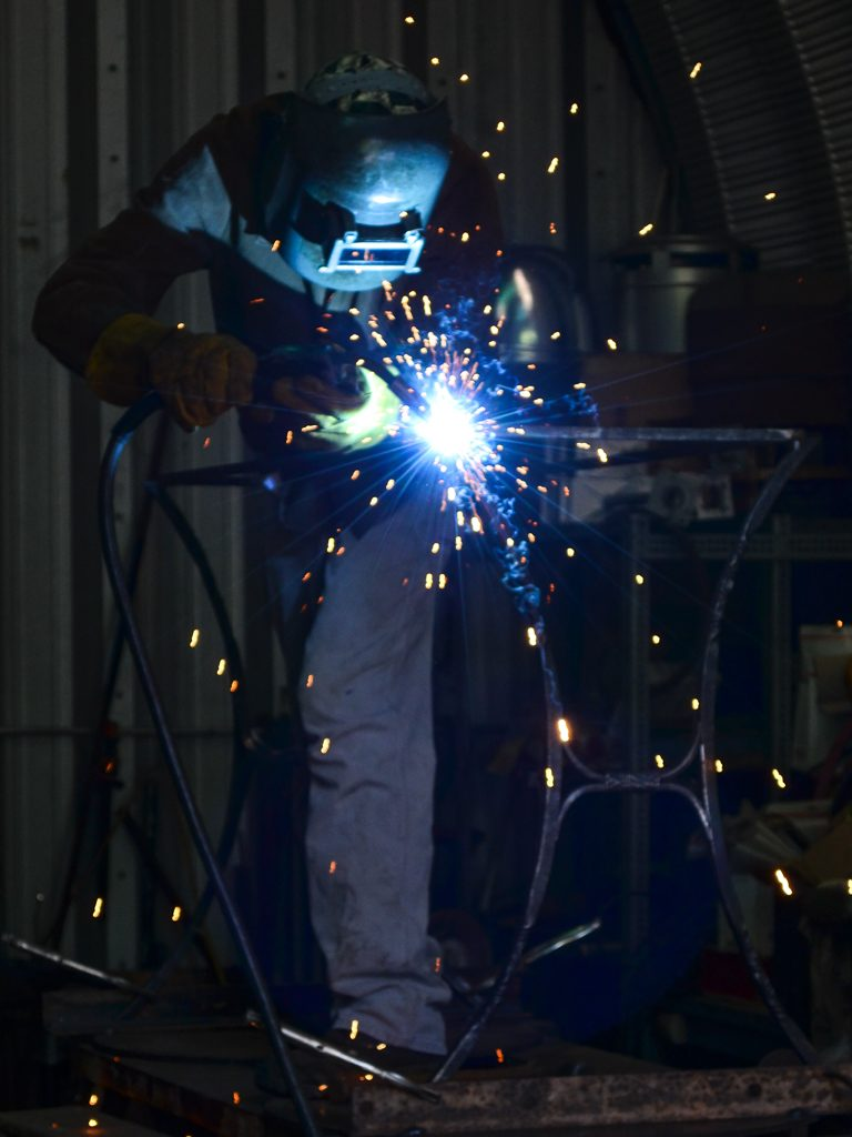 Jerry Dornbach welding a console table